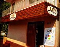 Fachada Madeira  Logo em ACM Adesivado Mercado UNI