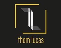 Logotipo Thom Lucas